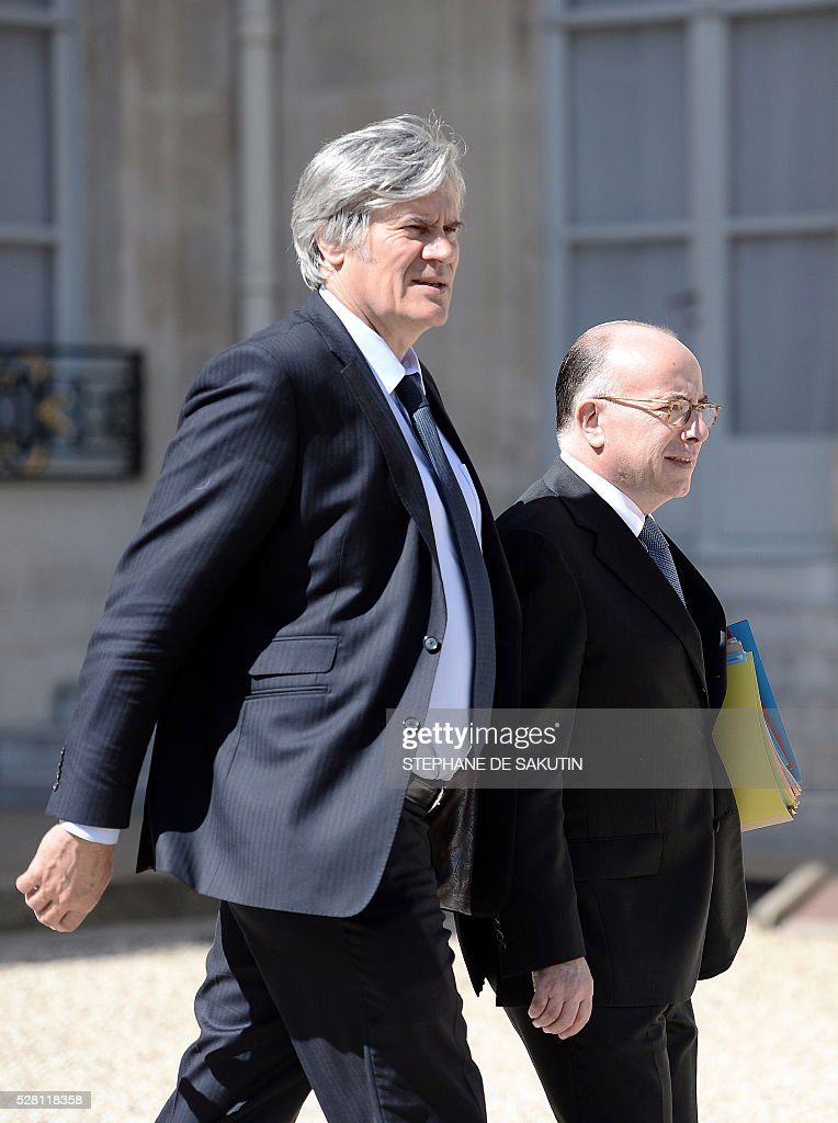 French Agriculture minister and Government spokesperson Stephane Le Foll (L) and French Interior minister Bernard Cazeneuve leave the Elysee presidential Palace after the weekly cabinet meeting in Paris on May 4, 2016 .
