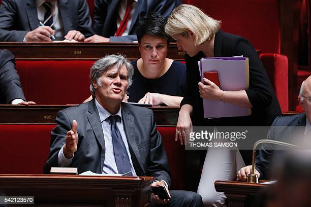 French Agriculture Minister and Government spokesperson Stephane Le Foll talks to French Junior Minister for Climate and Biodiversity Barbara Pompili...