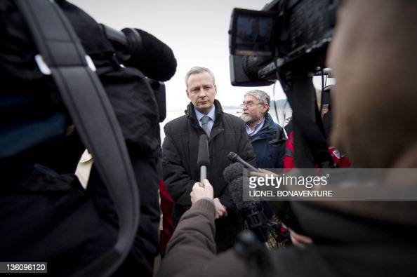 French agriculture minister Bruno Le Maire speaks to journalists as he visits an oyster farmer in LocoalMendon western France on December 19 2011 to...