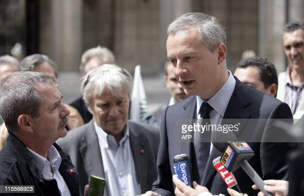 French Agriculture minister Bruno Le Maire speaks with French National Federation of Agricultural Holders' Unions General Secretary in charge of the...