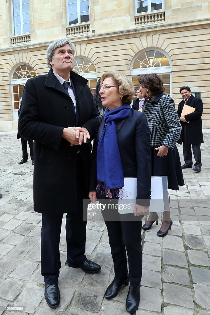 French Agriculture Minister Stephane Le Foll (L) and French Minister for Higher Education and Research Genevieve Fioraso arrive, on November 26, 2012 at the elite research institution College de France in Paris, to attend the opening of the meeting for Higher Education and Research.