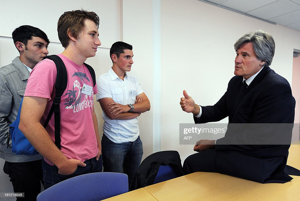 French Agriculture Minister Stephane Le Foll (R) talks to students during a visit at the Agricultural College of Rouillon, western France on September 4, 2012. Stephane Le Foll began his teaching career in this school after completing an agriculture advanced vocational diploma (BTS in French).
