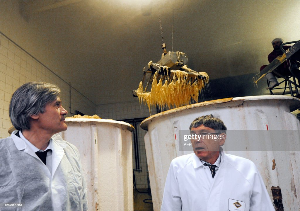 French Agriculture Minister Stephane Le Foll (L) talks with Gerald Christ (R), President of Christ SAS, a French firm specialized in canned cooked dishes and condiments, as he visits the sauerkraut unit, on January 11, 2013 at Connerre, western France.