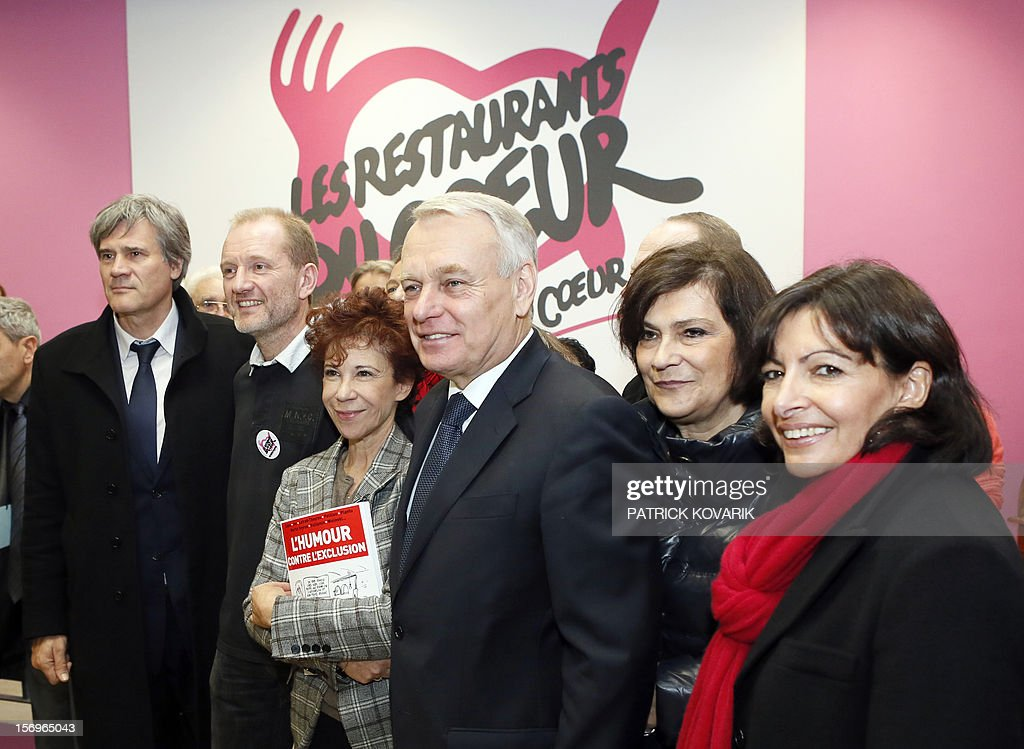 French Agriculture Minister Stephane Le Foll, the president of French charitable organisation 'Les Restos du Coeur' (Restaurants of the Heart), Olivier Berthe, the widow of French entertainer and funder of 'Les Restos du Coeur' Coluche, Veronique Colucci, French Prime Minister Jean-Marc Ayrault, French Junior Minister for Disabled People, Marie-Arlette Carlotti and Paris deputy mayor Anne Hidalgo participate on November 26, 2012 in Paris in the launching of the 28th winter campaign to distribute food to the needy.