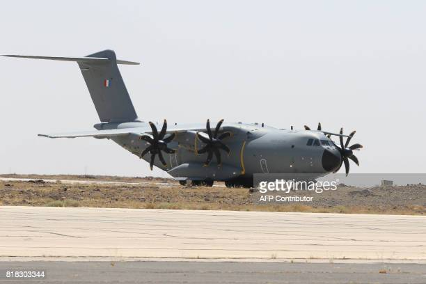 A French Air Force Airbus A400M Atlas sits on the tarmac of a military base in Jordan during a visit of the French defence minister on July 18 2017 /...