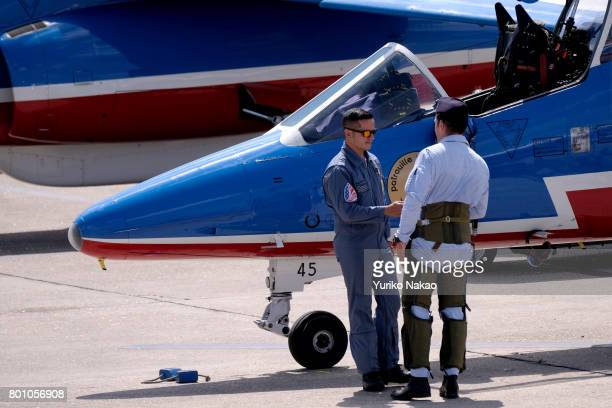 French Air Force pilot shakes hands with his member after a Patrouille de France aerial demonstration over the Le Bourget Airport on the first public...