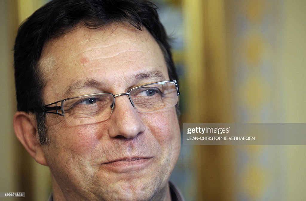 French Alain Berceaux, father of Alexandre Berceaux, a French hostage in Algeria who succeeded with other Algerian and foreigners to escape on January 17,2013 from the Tiguentourine gas field in southeastern Algeria, speaks with journalists on January 18, 2013 in Pagny-sur-Moselle, eastern France. The fate of some 30 foreigners hung in the balance today after Al-Qaeda-linked hostage-takers at a remote Algerian gas field demanded a prisoner swap and an end to French military action in Mali. VERHAEGEN