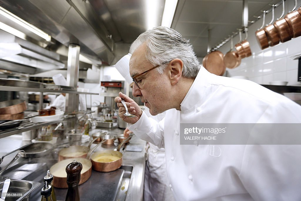 French Alain Ducasse cooks in the kitchen of his 'Louis XV' restaurant in the Hotel de Paris in Monaco which will be celebrating its 25th anniversary.