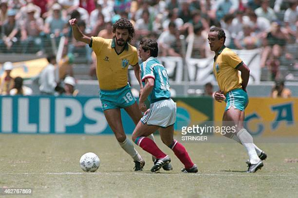 French Alain Giresse vies with Brazilian players Socrates and Elzo on June 21 1986 in Guadalaraja during the World Cup quarterfinal soccer match...