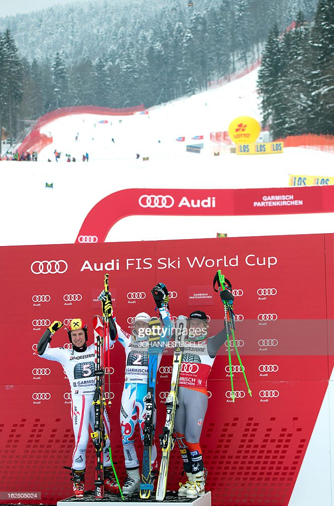 French Alexis Pinturault (C), Austrian Marcel Hirscher (L) and US Ted Ligety (R) celebrate their places after the FIS World Cup men's Giant Slalom first run competition in Garmisch-Partenkirchen, southern Germany, on February 24, 2013. Alexis Pinturault won the competition, Austrian Marcel Hirscher placed second and US Ted Ligety placed third.