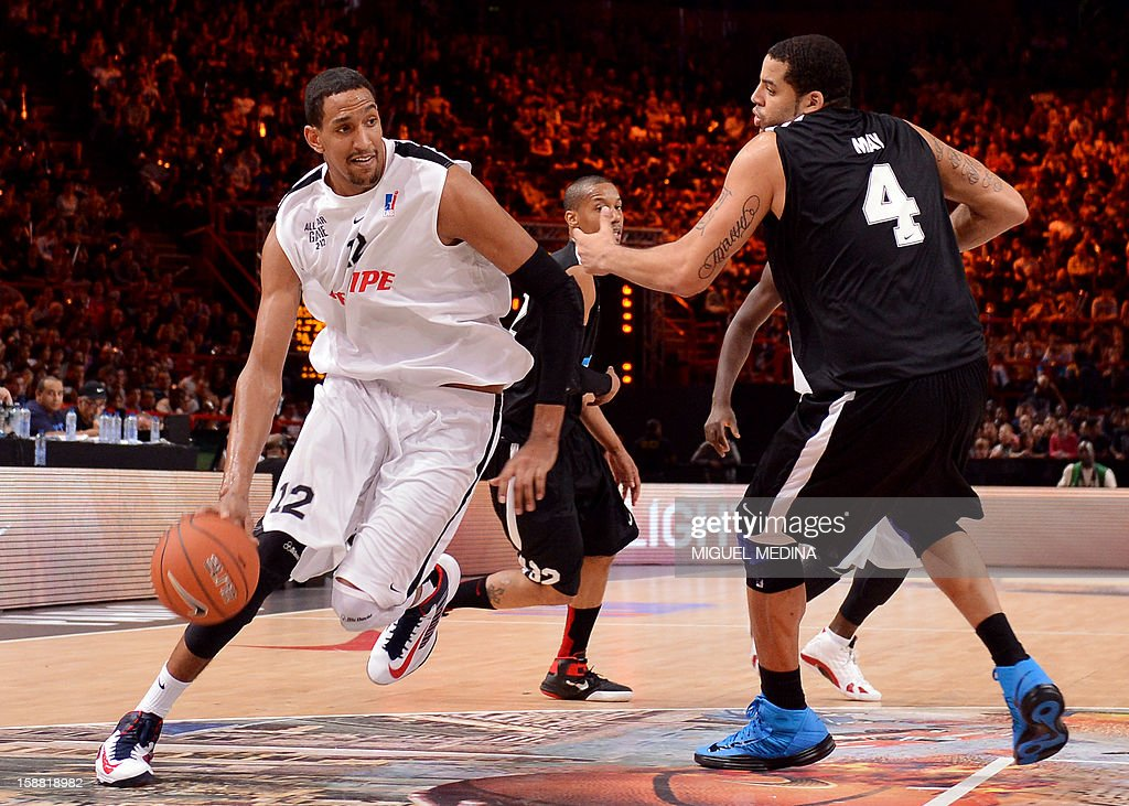 French All Star player Alexis Ajinca (L) vies with Foreign All Star player Sean May during France's national basketball league (LNB) 2010 All Star Game match on December 30, 2012 at the Palais Omnisport de Paris-Bercy (POPB) in Paris. AFP PHOTO / MIGUEL MEDINA