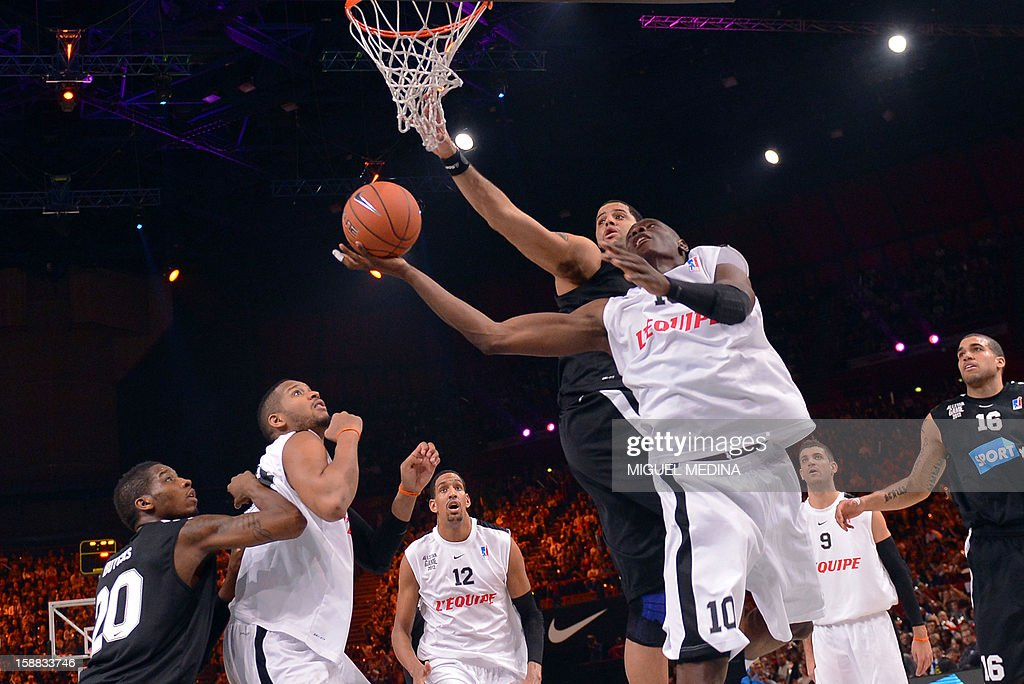 French All star player Amara Sy (R) jumps to score during the France's national basketball league (LNB) 2012 All Star Game on December 30, 2012 at the Palais Omnisport de Paris-Bercy (POPB) in Paris. AFP PHOTO MIGUEL MEDINA