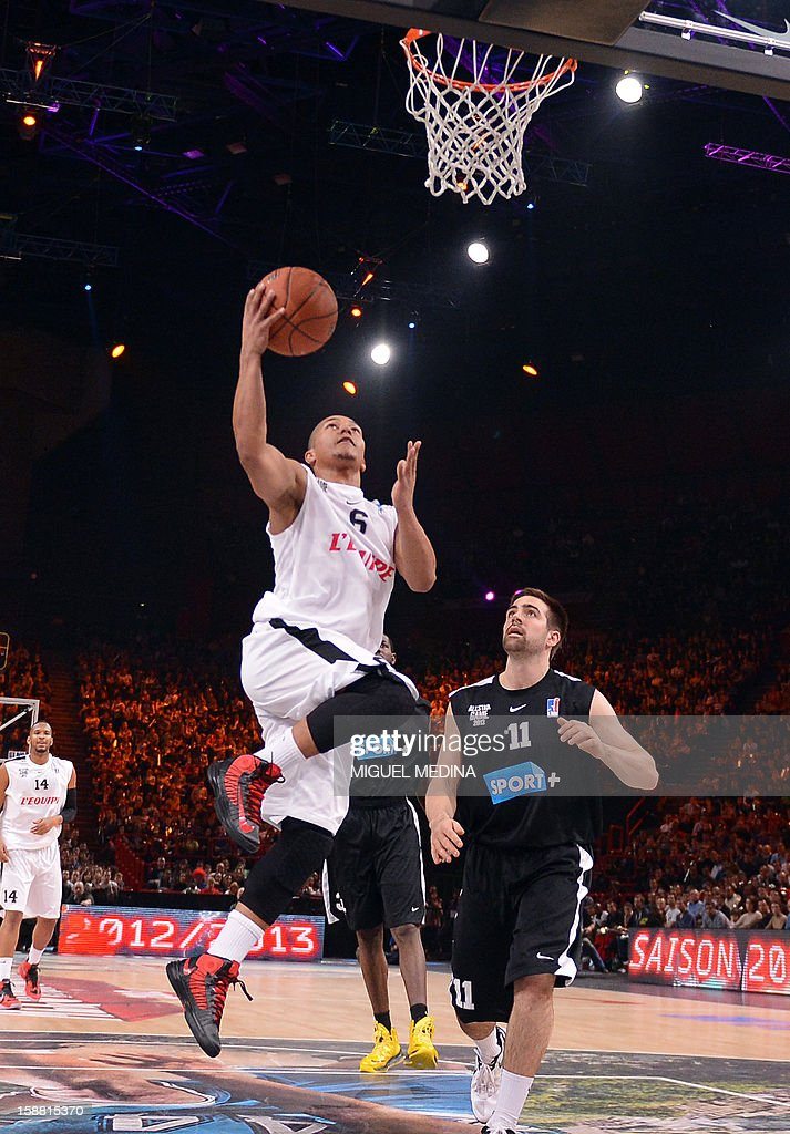 French All star player Marc-Antoine Pellin (L) jumps to score jumps to score against Foreign ProA All Star player US Kyle McALarney during the France's national basketball league (LNB) 2012 All Star Game on December 30, 2012 at the Palais Omnisport de Paris-Bercy (POPB) in Paris. AFP PHOTO MIGUEL MEDINA