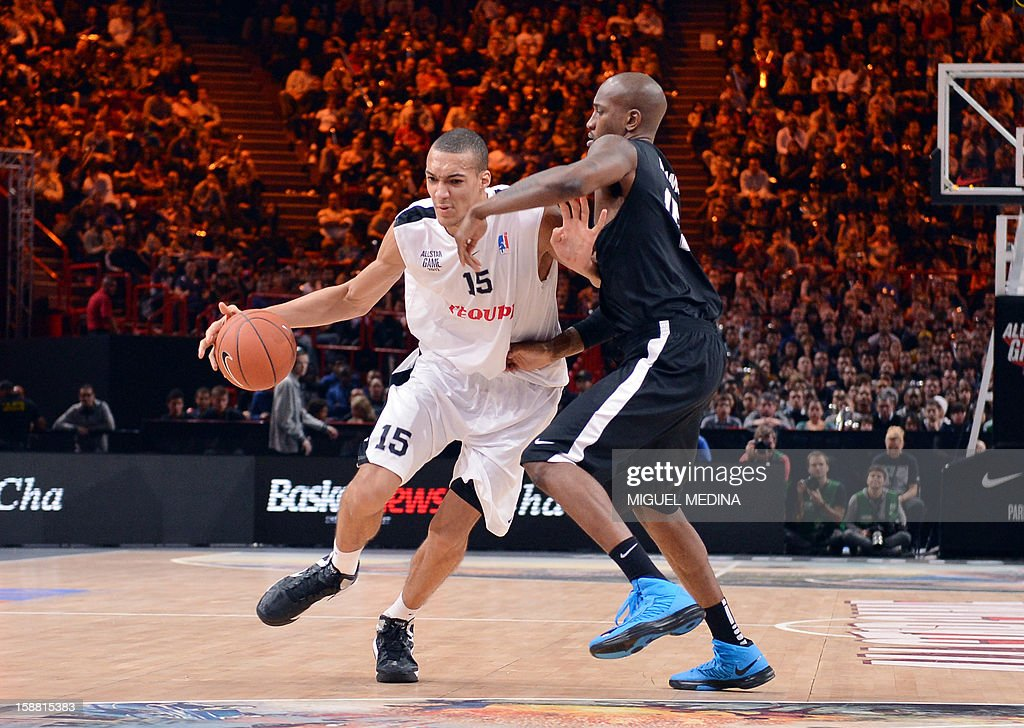 French All star player Rudy Gobert (L) vies against a Foreign ProA All Star US player Jawad Williams (R) during the France's national basketball league (LNB) 2012 All Star Game on December 30, 2012 at the Palais Omnisport de Paris-Bercy (POPB) in Paris. AFP PHOTO MIGUEL MEDINA