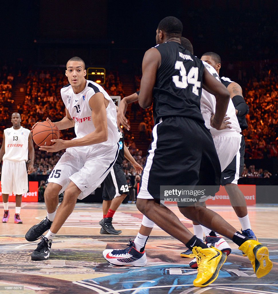 French All star player Rudy Gobert (L) vies against Foreign ProA All Star players during the France's national basketball league (LNB) 2012 All Star Game on December 30, 2012 at the Palais Omnisport de Paris-Bercy (POPB) in Paris. AFP PHOTO MIGUEL MEDINA