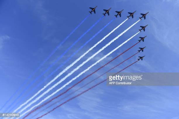 TOPSHOT French AlphaJet of the Patrouille de France fly over Paris during the annual Bastille Day military parade on the ChampsElysees avenue in...