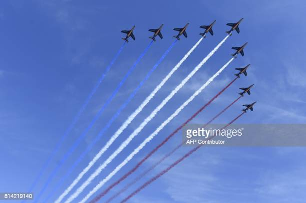 French AlphaJet of the Patrouille de France fly over Paris during the annual Bastille Day military parade on the ChampsElysees avenue in Paris on...