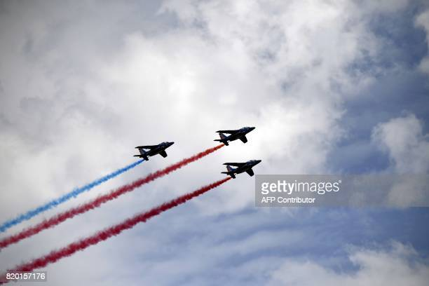 French AlphaJet of the Patrouille de France fly over Sisteron during the 2225 km nineteenth stage of the 104th edition of the Tour de France cycling...