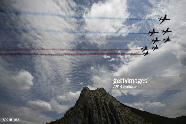 TOPSHOT French AlphaJet of the Patrouille de France fly over the Rocher de la Baume in Sisteron during the 2225 km nineteenth stage of the 104th...