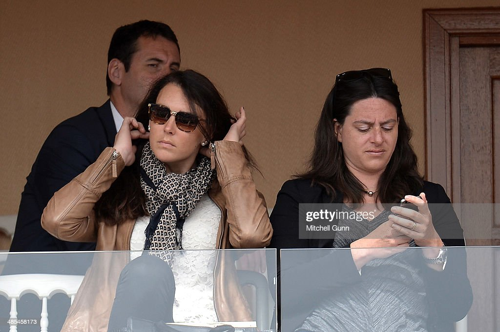 French alpine ski racer Nastasia Noens (L) watches Stanislas Wawrinka of Switzerland and Milos Raonic of Canada during their quarter final match on day six of the ATP Monte Carlo Masters, at the Monte-Carlo Country Club on April 18, 2014 in Monte-Carlo, Monaco.