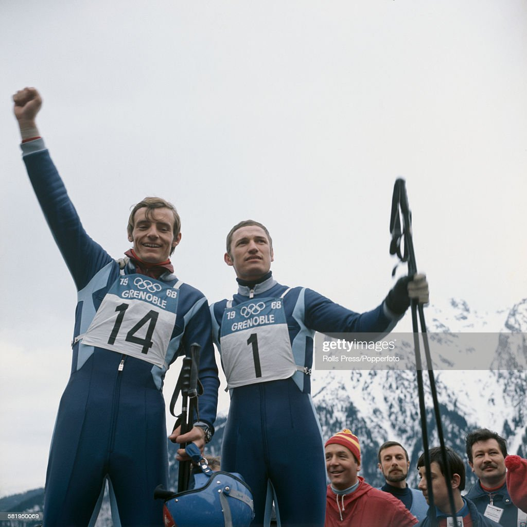 French alpine skiers <a gi-track='captionPersonalityLinkClicked' href=/galleries/search?phrase=Jean-Claude+Killy&family=editorial&specificpeople=223880 ng-click='$event.stopPropagation()'>Jean-Claude Killy</a> (on left) and Guy Perillat celebrate after winning the gold and silver medals respectively in the men's downhill event at the 1968 Winter Olympics in Grenoble, France on 9th February 1968.