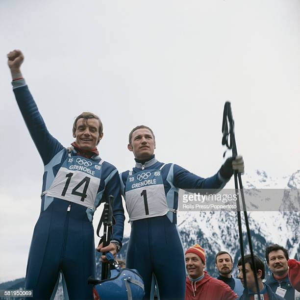 French alpine skiers JeanClaude Killy and Guy Perillat celebrate after winning the gold and silver medals respectively in the men's downhill event at...