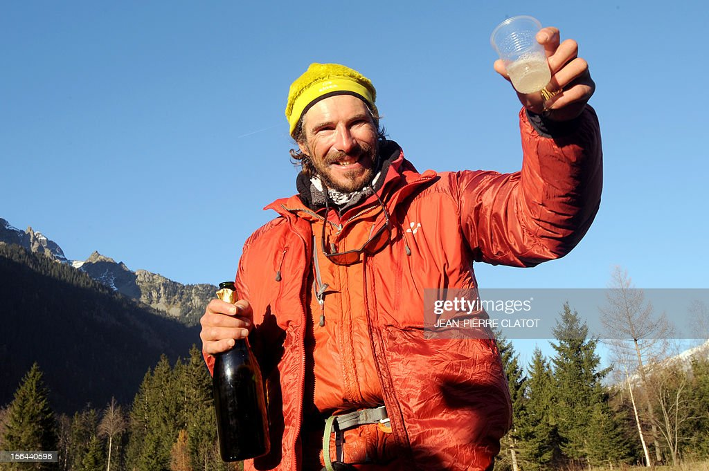 AGASSE - French alpinist Lionel Daudet celebrates upon his arrival in Chamonix, on November 15, 2012, at the end of his trip around France following coastal and terrestrial borders without any motorized transport, walking more than 5000 km and crossing 1000 mountain tops.