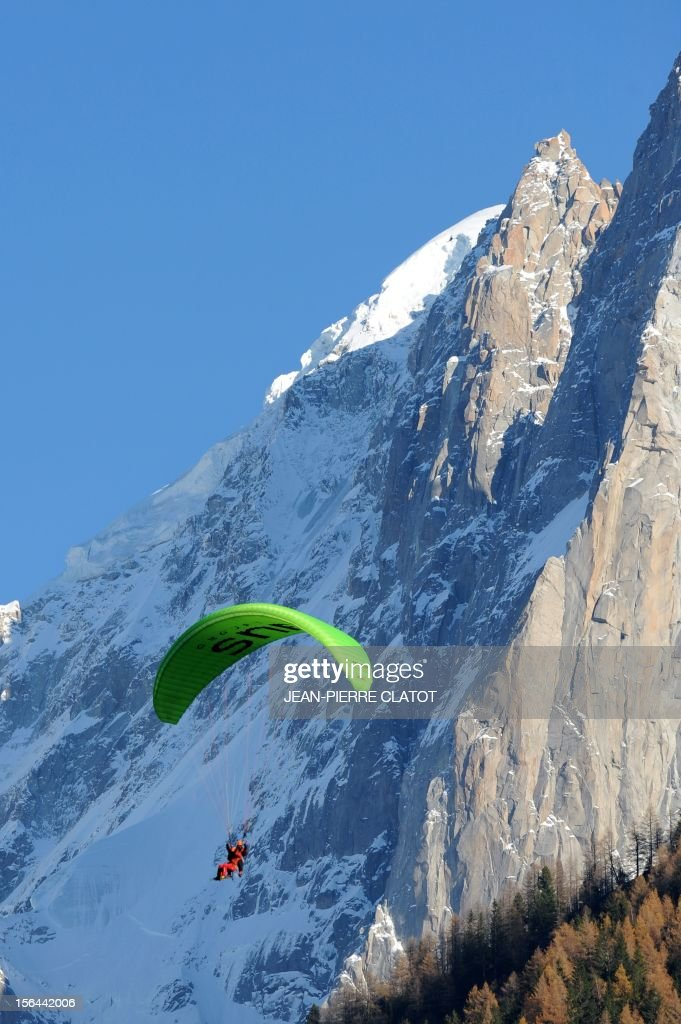 AGASSE - French alpinist Lionel Daudet does paragliding from above Chamonix, on November 15, 2012, at the end of his trip around France following coastal and terrestrial borders without any motorized transport, walking more than 5000 km and crossing 1000 mountain tops.