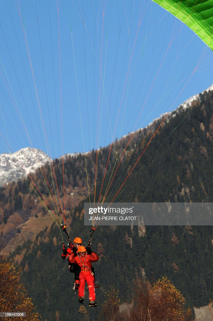 AGASSE - French alpinist Lionel Daudet does paragliding from above Chamonix, on November 15, 2012, at the end of his trip around France following coastal and terrestrial borders without any motorized transport, walking more than 5000 km and crossing 1000 mountain tops. AFP PHOTO / JEAN-PIERRE CLATOT