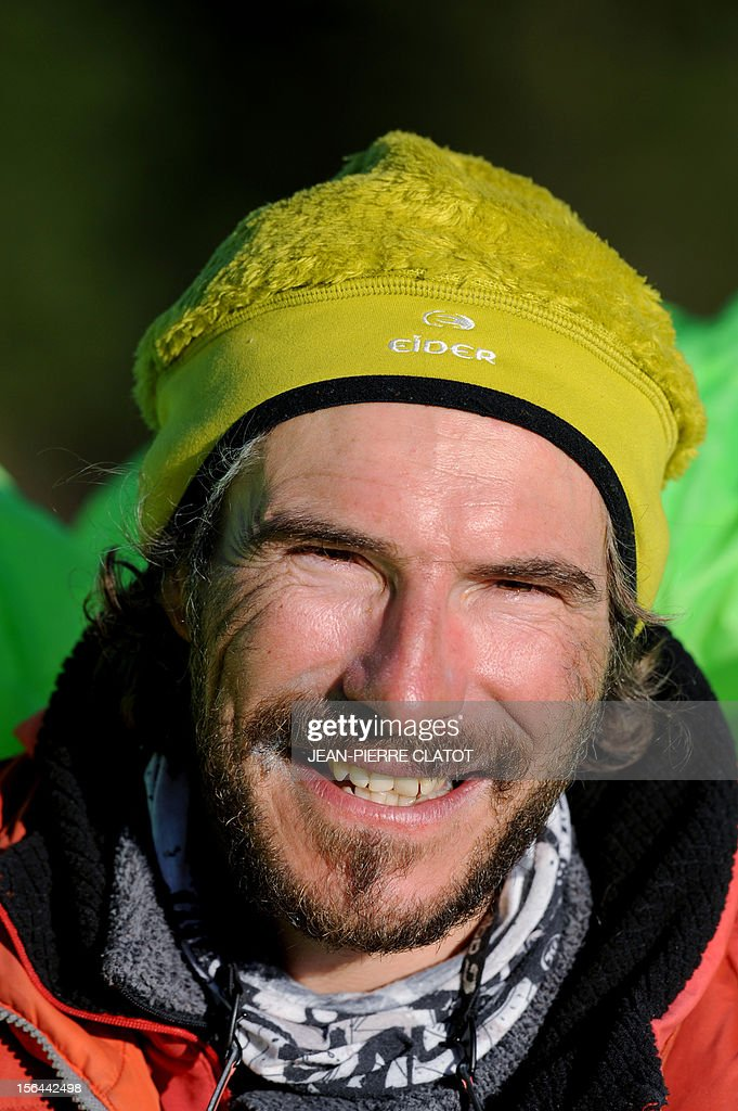 AGASSE - French alpinist Lionel Daudet poses upon his arrival in Chamonix, on November 15, 2012, at the end of his trip around France following coastal and terrestrial borders without any motorized transport, walking more than 5000 km and crossing 1000 mountain tops. AFP PHOTO / JEAN-PIERRE CLATOT