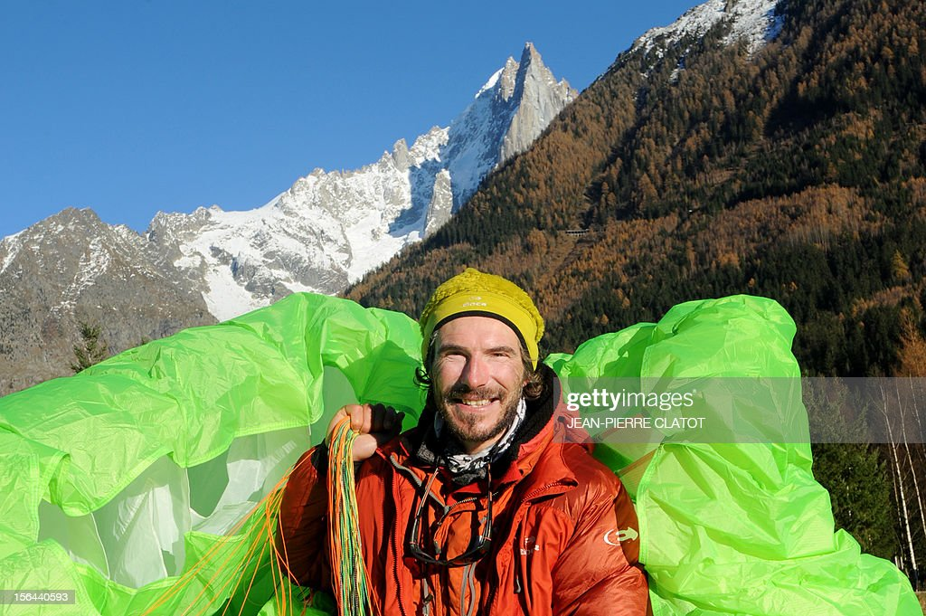 French alpinist Lionel Daudet poses with his paragliding upon his arrival in Chamonix, on November 15, 2012, at the end of his one-year trip around France following coastal and terrestrial borders without any motorized transport, walking more than 5000 km and crossing 1000 mountain tops.