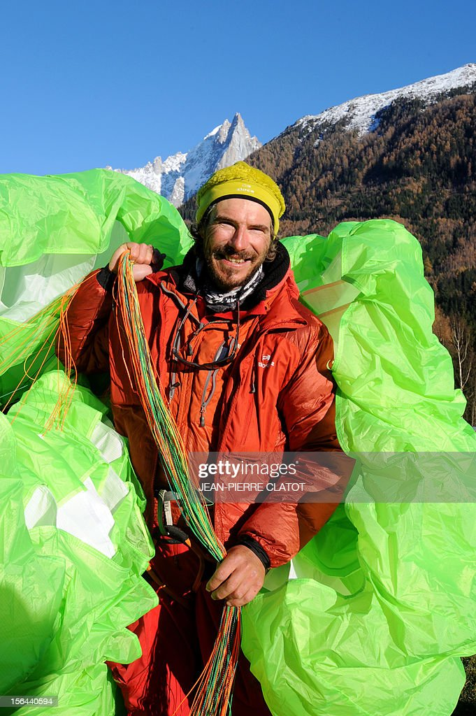 AGASSE - French alpinist Lionel Daudet poses with his paragliding upon his arrival in Chamonix, on November 15, 2012, at the end of his trip around France following coastal and terrestrial borders without any motorized transport, walking more than 5000 km and crossing 1000 mountain tops.