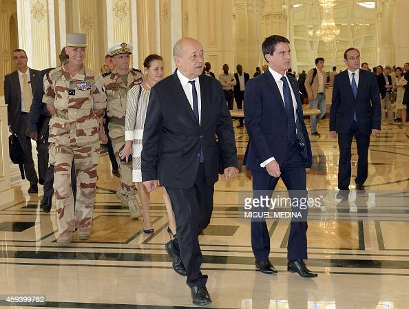 French Ambassador in Chad Evelyne Decorps French Prime Minister Manuel Valls and French Defence Minister JeanYves Le Drian arrive for a meeting with...