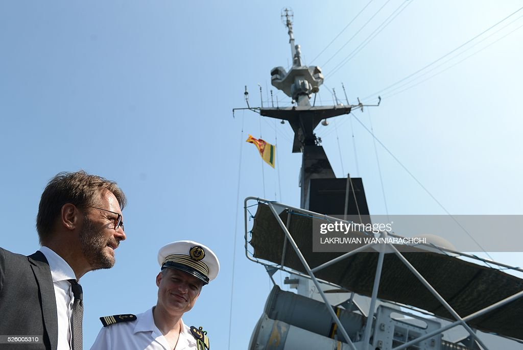 French ambassador Jean-Marin Schuh (L) and Captain Laurent Machard de Gramont talk aboard French naval ship Aconit at Sri Lanka's Colombo harbour on April 29, 2016. The French navy vessel is on a week-long visit to Sri Lankas main sea port of Colombo. / AFP / LAKRUWAN