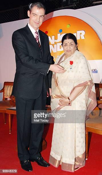 French Ambassador to India Jérôme Bonnafont felicitates Singing legend Lata Mangeshkar with the 'Officier de la Legion d'honneur' France's highest...