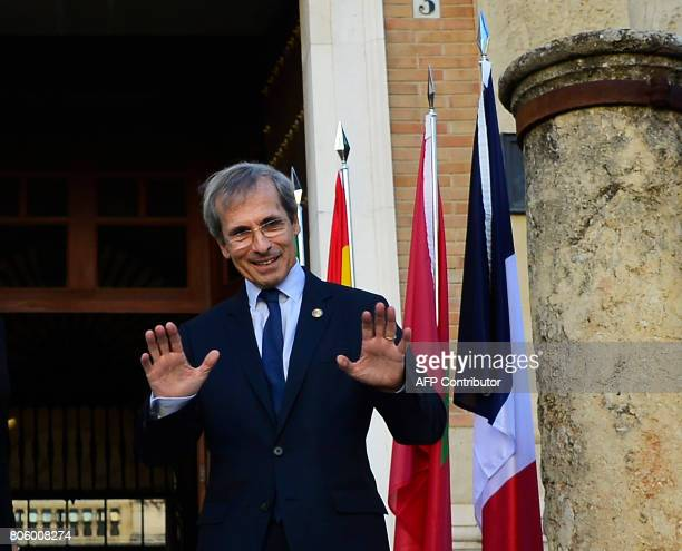 French Ambassador to Spain Yves SaintGeours gestures as he poses before a meeting at the 'Archivo General de Indias' in Seville on July 3 during the...