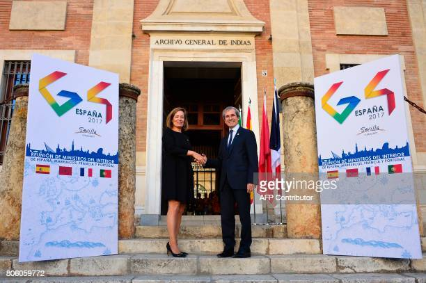 French Ambassador to Spain Yves SaintGeours shakes hands with Director of Internal Relations for the Ministry of the Interior Elena Garzon before a...