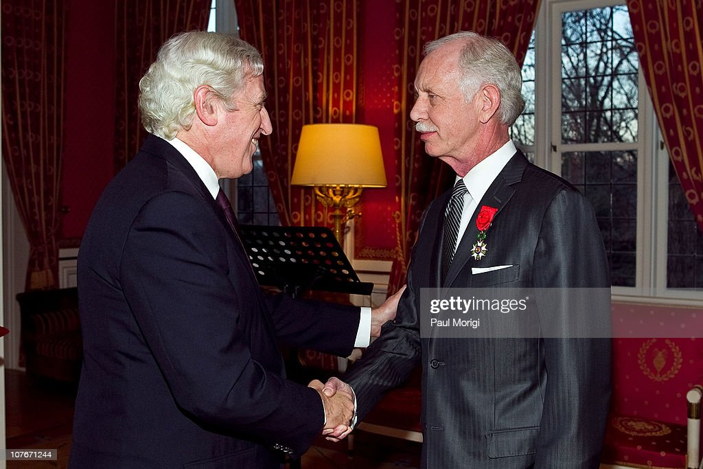 French Ambassador to the United States Pierre Vimont (L) presents US Airways Capt. Chesley 'Sully' Sullenberger (Ret.) the National Order of the Legion of Honour Officier Award at the French Ambassador's Residence on December 17, 2010 in Washington, DC.