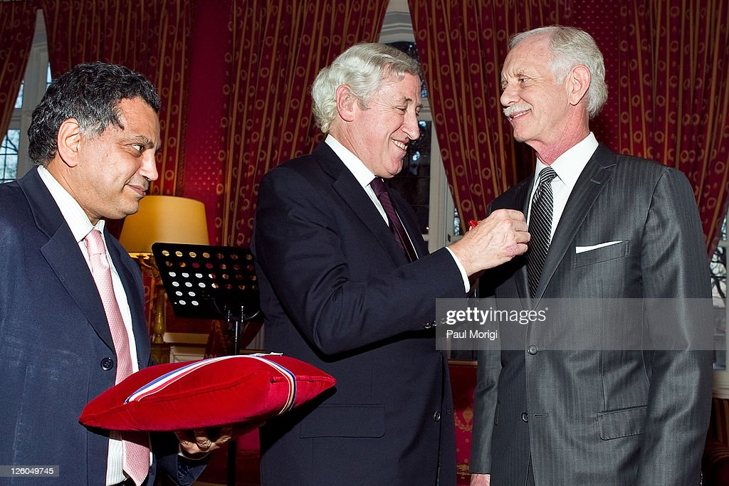 French Ambassador to the United States Pierre Vimont (C) presents US Airways Capt. Chesley 'Sully' Sullenberger (Ret.) (R) the National Order of the Legion of Honour Officier Award at the French Ambassador's Residence on December 17, 2010 in Washington, DC.