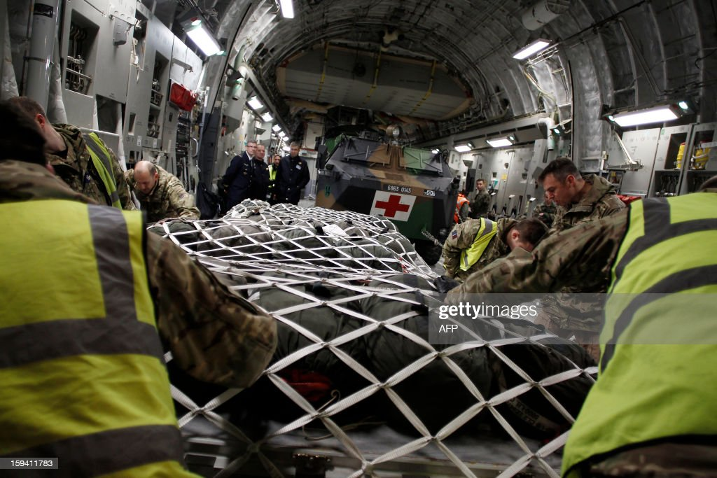 French and British soldiers load material in a British army Boeing C-17 cargo aircraft arriving from British Brize Norton base en route to Bamako, on January 13, 2013 at the Evreux military Base. Britain supports France's decision to send troops to support an offensive by Mali government forces against Islamist rebels.