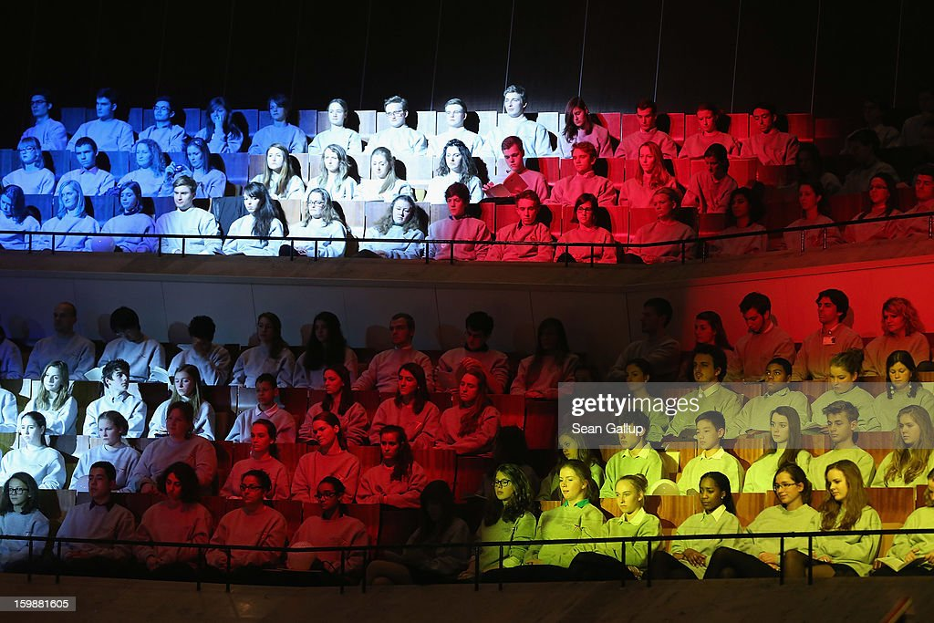 French and German students bathed ín the colors of the French and German flags attend a concert at the Berlin Philharmonic during the 50th anniversary celebration of the Elysee Treaty on January 22, 2013 in Berlin, Germany. The treaty, concluded in 1963 by Charles de Gaulle and Konrad Adenauer in the Elysee Palace in Paris, set a new tone of reconciliation between France and Germany, and called for consultations between the two countries to come to a common stance on policies affecting the most important partners in Europe as well as the rest of the region. Since its establishment, the document for improved bilateral relations has been seen by many as the driving force behind European integration.
