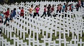 French and German youths take part in a show at the French National cemetery outside the Douaumont Ossuary northeastern France on May 29 during a...