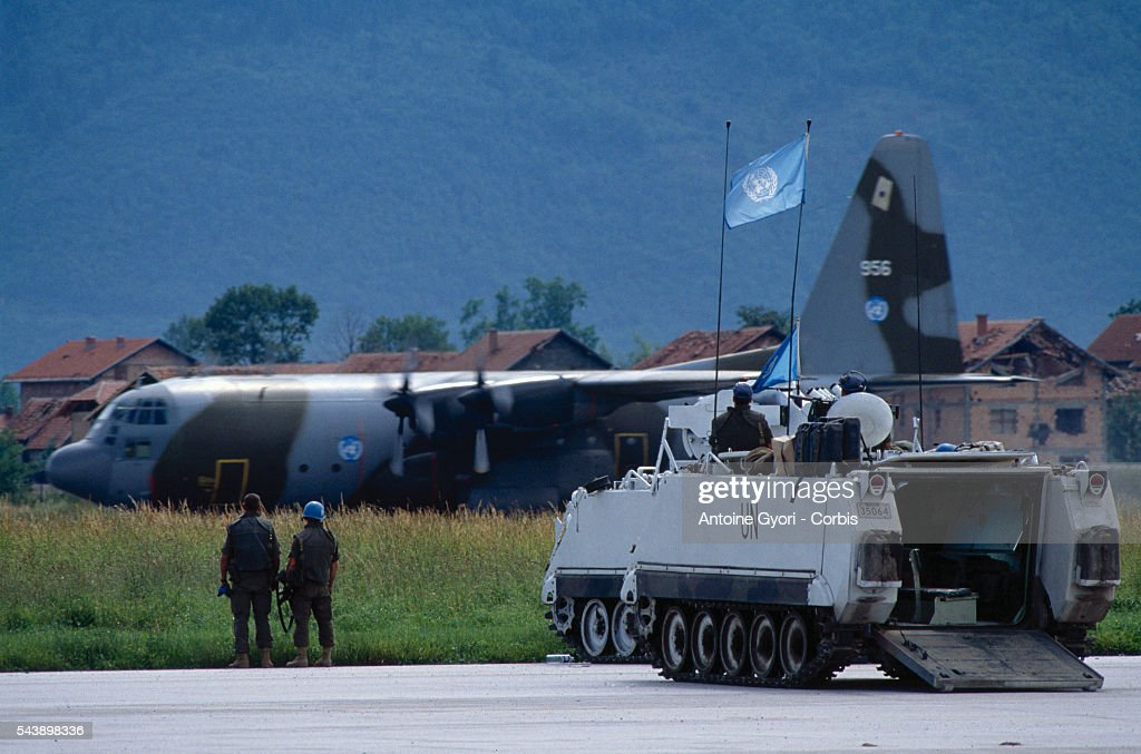 French and Norwegian planes arrive at the Sarajevo airport in preparation for an airlift UN troops in armored personnel carriers guard them