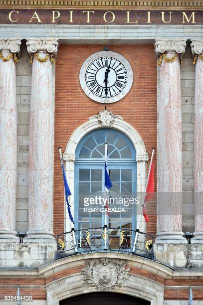 EU French and Toulouse City flags are seen bound by black tape at The City Hall in Toulouse on August 19 as a mark of solidarity after terror attacks...
