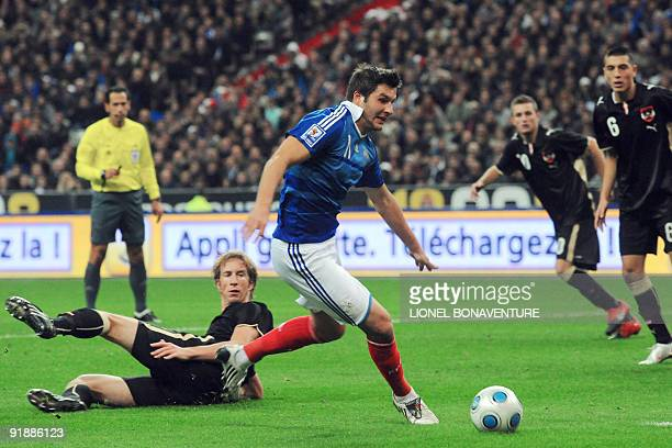 French Andre Pierre Gignac vies with Austrian Jurgen Patocka during the World Cup 2010 qualifying football match France vs Austria on October 14 2009...