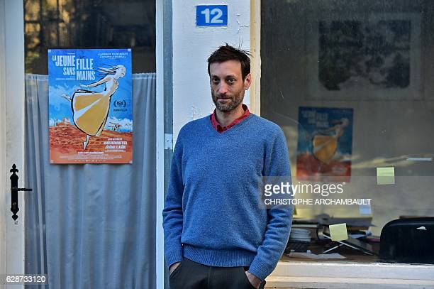 French animation film designer Sebastien Laudenbach poses outside his workshop in Paris on November 30 2016 'The young woman without hands' is the...