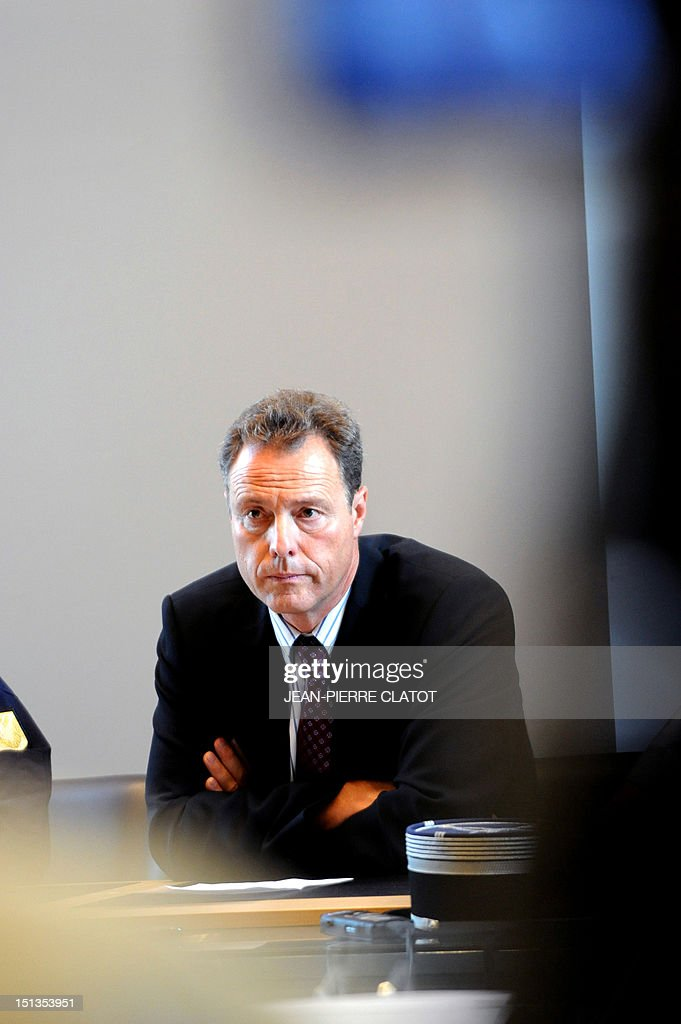 French Annecy's prosecutor, Eric Maillaud takes part in a press conference at the courthouse of the southeastern French city of Annecy on Septembre 6, 2012, after four people were shot dead in or close to a British-registered car that was found in a forest car park on the edge of the French Alpine village of Chevaline. The car, a BMW, contained the bodies of a man, in the front, and two women who were seated in the back, police said.