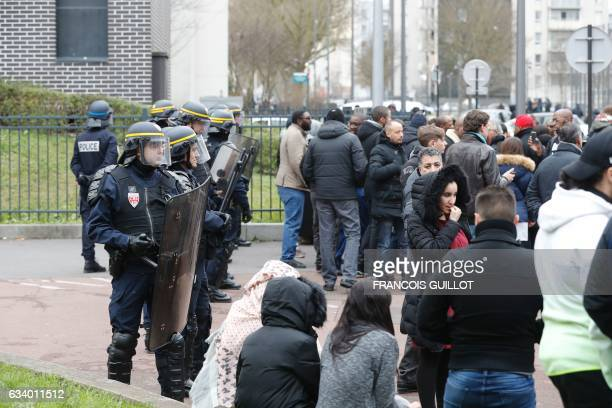 French anti riot police officers stand guard as people gather during a protest on February 6 2017 in AulnaysousBois northern Paris a day after a...
