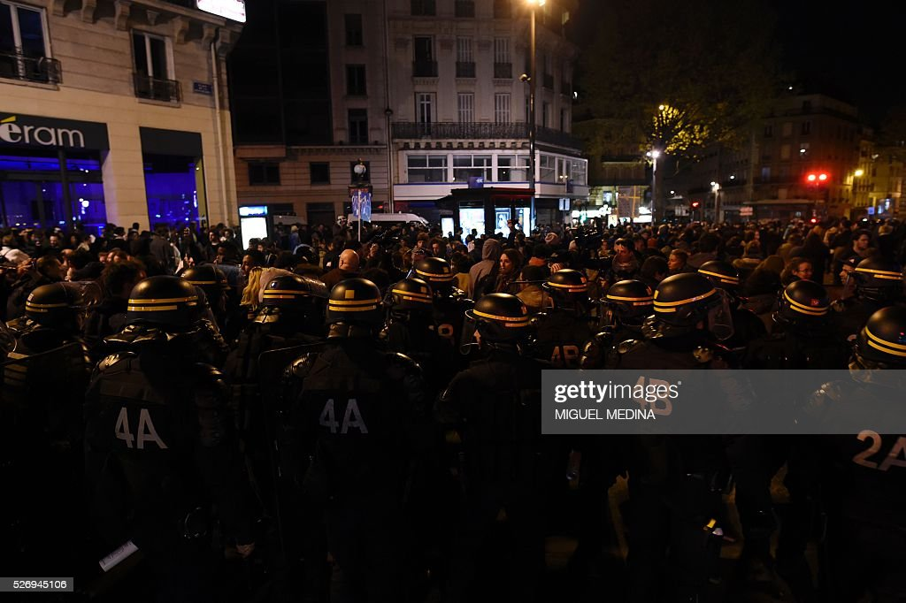French anti riot policemen face protesters as they block the access to the Place de la Republique after protesters taking part in the Nuit Debout (Up All Night) movement against the French government's proposed labour reform, being evacuated by police from the Place de la Republique in Paris, on May 1, 2016.