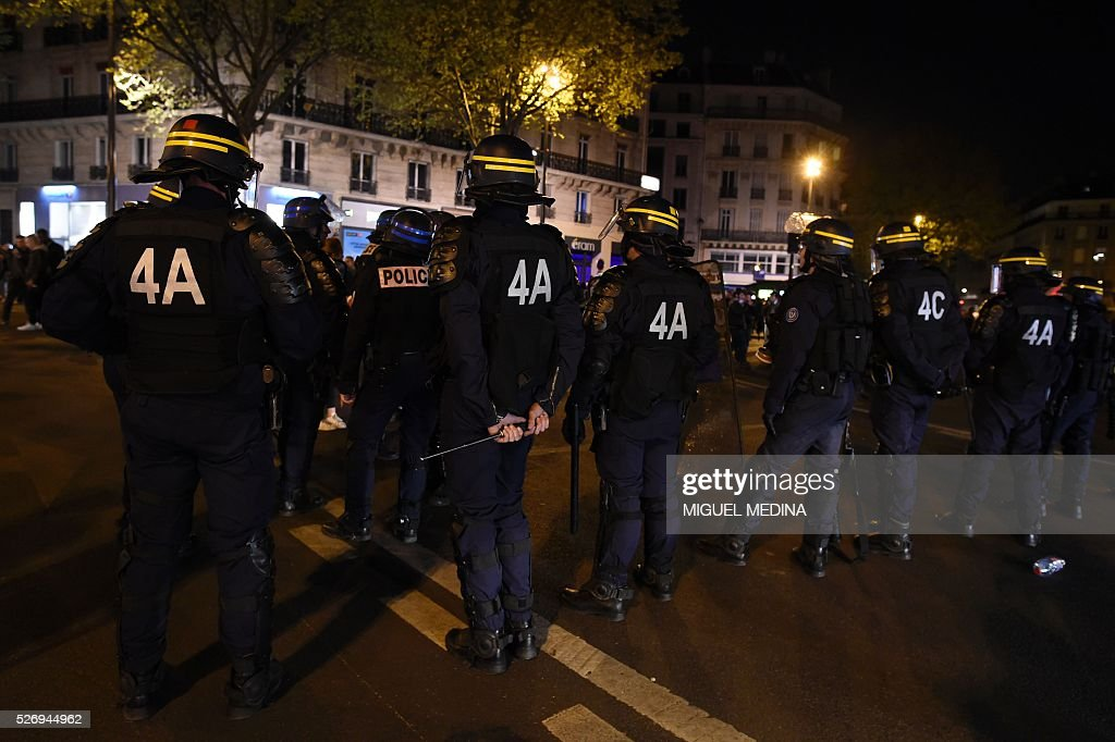 French anti riot policemen stand to block the access to the Place de la Republique after protesters taking part in the Nuit Debout (Up All Night) movement against the French government's proposed labour reform, being evacuated by police from the Place de la Republique in Paris, on May 1, 2016.